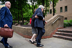 © Licensed to London News Pictures. 22/05/2017. London, UK.  Entertainer ROLF HARRIS stumbles as he arrives at Southwark Crown Court in London with his niece JENNY HARRIS (right). Harris, who was jailed on twelve counts of indecent assault on four female victims in 2012, is now standing trial accused of further indecent assaults. Photo credit: Ben Cawthra/LNP
