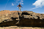 Ethan Welty stands on the summit of a rock formation in Smith Rock State Park, Oregon.