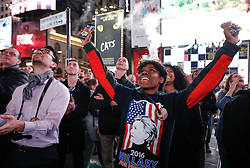 © Licensed to London News Pictures. 09/11/2016. New York City, USA. Members of the public react to news that Donald Trump looks likely to be elected as the next president of the United States, while gathering in Times Square, New York City, on Wednesday, 9 November. Photo credit: Tolga Akmen/LNP