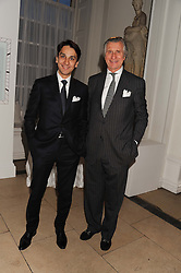 Left to right, FRANCOIS LE TROQUER MD Cartier UK and ARNAUD BAMBERGER Executive Chairman Cartier UK at a reception to present the new Cartier Tank Watch Collection held at The Orangery, Kensington Palace Gardens, London W8 on 19th April 2012.