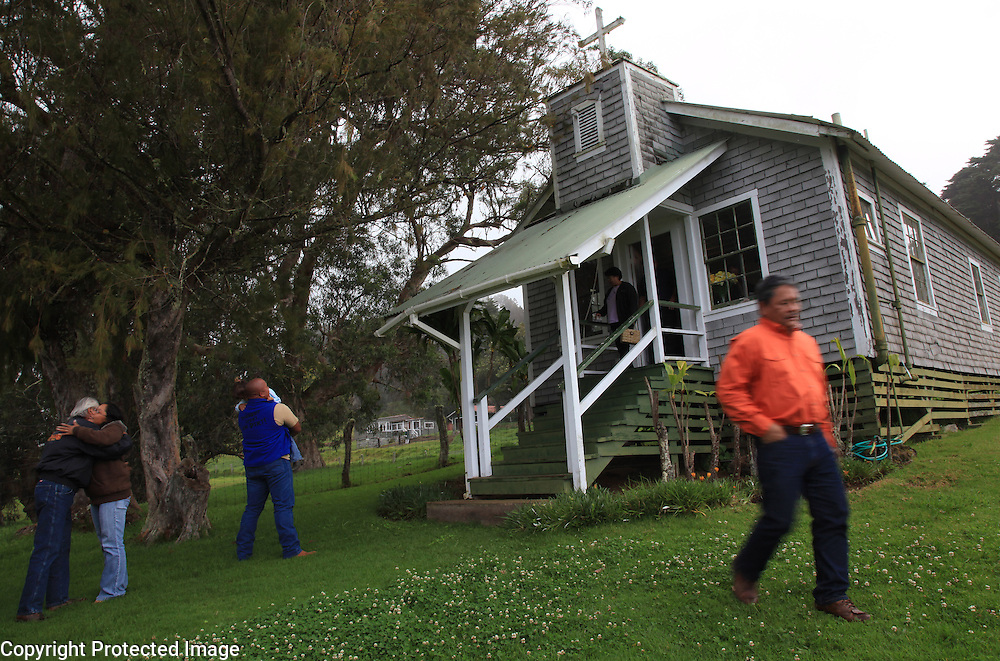 """Worshippers leave the Kahua Ranch chapel which was originally the Lorenzo Lyons' missionary chapel in Ho'epa and was moved to Kahua in 1953 to be used by cowboys and their families on the ranch in North Kohala, Hawaii.  """"Faith is a huge part of the paniolo identity,"""" says Paniolo Preservation Society founder, Dr, Billy Bergin.  Many of the cowboys attend a larger """"cowboy church"""" in downtown Waimea."""