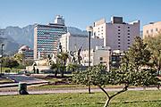 Fuente de Neptuno or Neptune Fountain and city skyline in the Macroplaza square in the Barrio Antiguo neighborhood of Monterrey, Nuevo Leon, Mexico.