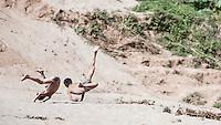 Children playing by the Nam Ou river near Luang Prabang in Laos