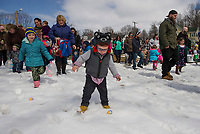 Cohen Moulton finds his first Easter Egg on Sunday afternoon during Laconia Parks and Recreation Easter egg hunt at Leavitt Park.  (Karen Bobotas/for the Laconia Daily Sun)