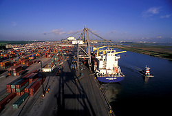 Aerial view of container ship docked next to shipping containers on dock at the Port of Houston.