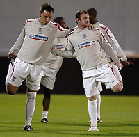 Photo: Richard Lane<br />England Training Session. 10/10/2006. <br />England's John Terry and Wayne Rooney stretch.