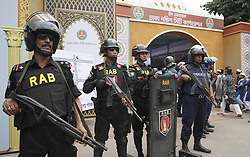September 2, 2017 - Dhaka, Bangladesh - September 02, 2017- Dhaka, Bangladesh- A group of security guards stand in front of National Eid ground in the Dhaka city. Thousands of people attends for Eid prayer the main Eid prayer ground at National Eidgah in the Dhaka city on 02 September 2017 in Dhaka, Bangladesh. After the prayers, people will slaughter the cattle. Muslims across the world celebrate the annual festival of Eid al-Adha, or the Festival of Sacrifice. September, 2017 Dhaka, Bangladesh © Monirul Alam(Credit Image: © Monirul Alam via ZUMA Wire)