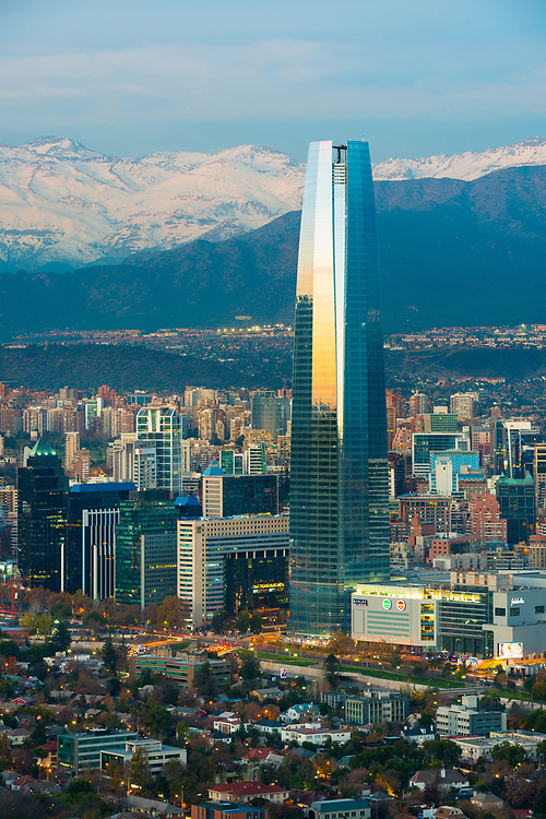 Santiago, Region Metropolitana, Chile - Panoramic view of Providencia and Las Condes districts with Costanera Center skyscraper and Los Andes Mountain Range in the back.
