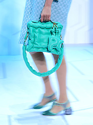 A close-up of a model on the catwalk during the Anya Hindmarch London Fashion Week SS18 show held at Lindley Hall, London.
