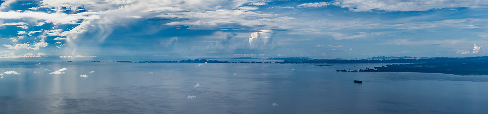Perhaps 1000 karst islands of SW Misool, Raja Ampat, Papua Barat & top rhs Ceram's mountains, Maluku, Indonesia.