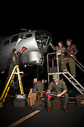 Living history crew reenacting preparation for a bombing mission over Europe at night.