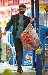 © Licensed to London News Pictures. 02/11/2020.  <br /> Crayford, UK. A masked shopper carrying toys. Due to the second lockdown announcement by Prime Minister Boris Johnson at the weekend the number of Christmas shopping days has been halved. Shoppers on a late night panic buying spree at a Smyths toys superstore in Kent. Photo credit:Grant Falvey/LNP
