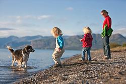 Writer Teresa Earle and her daughters enjoying the beach at Kluane Lake, Yukon near Kluane Lake Research Station