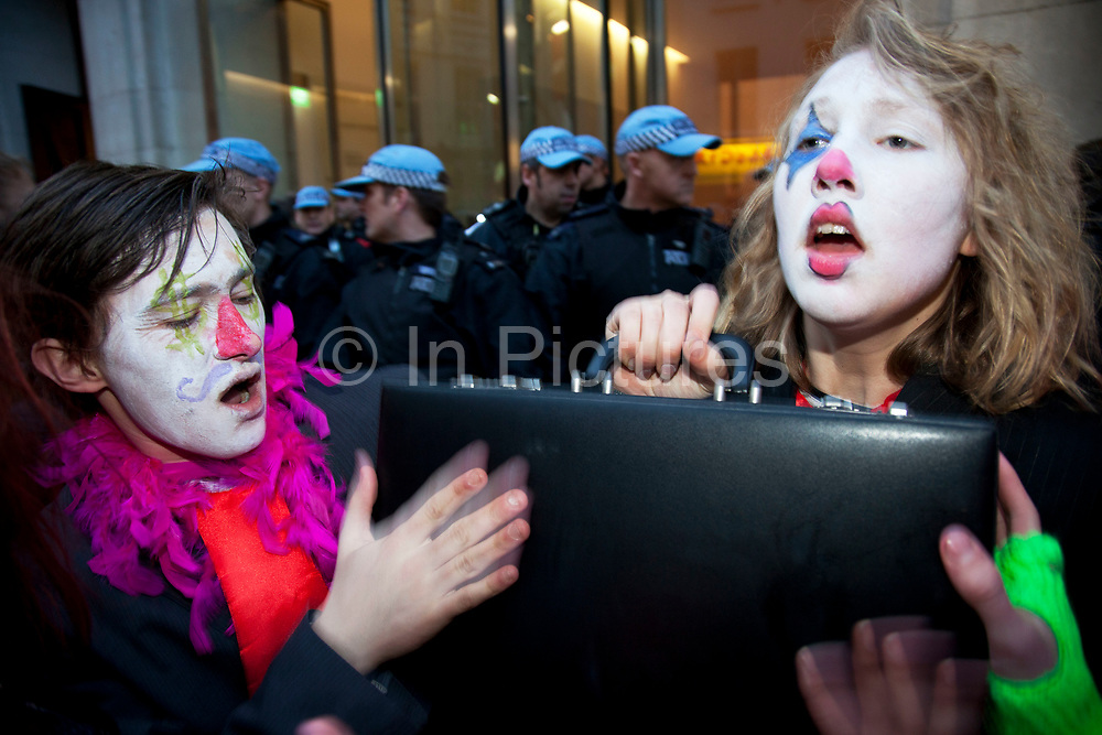 Anti-capitalist protesters dressed as banker clowns split off from the main N30 protest and demonstrated on Panton Street. Mocking police and bankers, they were the entertainment in a situation where the police 'contained' or kettled protesters.