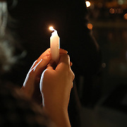 A student holds a lit candle during a candlelight vigil in memory of American freelance journalist Steven Sotloff at the University of Central Florida in Orlando, Florida, USA, 03 Septemvber 2014. Sotloff was reportedly executed by the Islamic State according to a video released by the group on 02 September. Sotloff was a former student at the university.