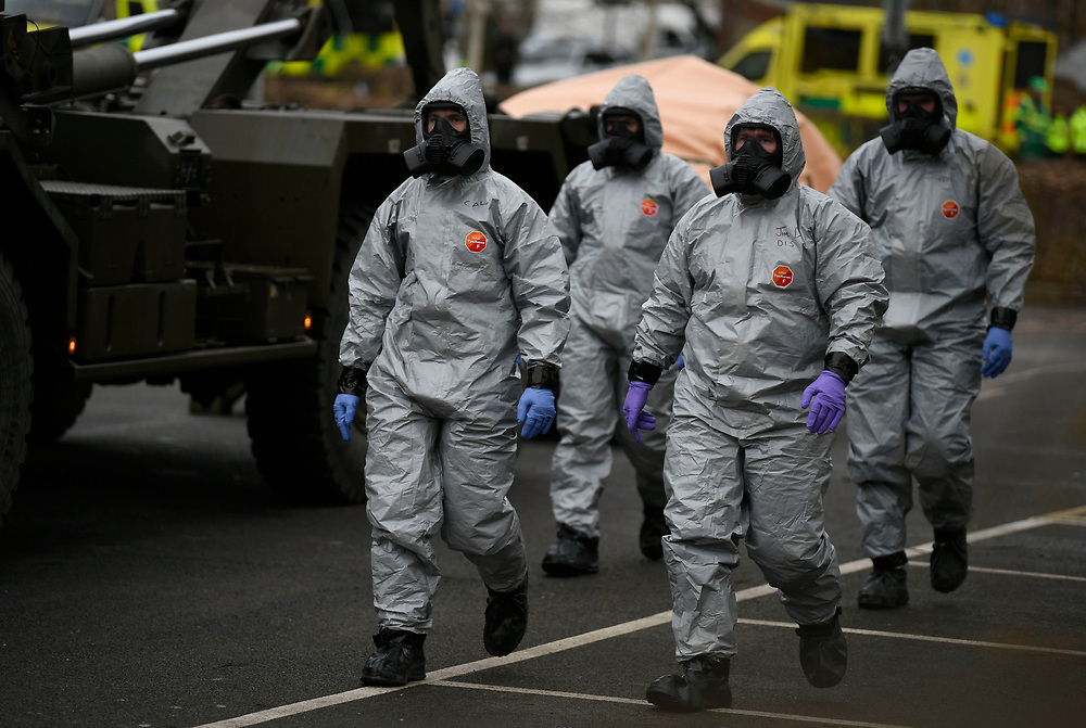 Military in protective clothing remove vehicles from a car park in Salisbury, Britain, 11 March 2017. Russian ex-spy Sergei Skripal and his daughter were attacked with a nerve agent on 04 March 2018. Skripal and his daughter Yulia remain in a 'very serious' condition. EPA-EFE/NEIL HALL