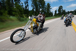 Mark Persichettin of Flat Broke Choppers and Dana Manconi on the Twisted Tea chopper on the Cycle Source Ride up Vanocker Canyon to Nemo during the Sturgis Black Hills Motorcycle Rally. SD, USA. Wednesday, August 7, 2019. Photography ©2019 Michael Lichter.