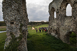 © Licensed to London News Pictures. 16/04/2017. Ripley, UK. Parishioners attend an Easter Sunday dawn service in the ruins of Newark Priory. The priory, which was established towards the end of the 12th century, lies near the banks of the River Wey and is only accessible once a year at Easter.  Photo credit: Peter Macdiarmid/LNP