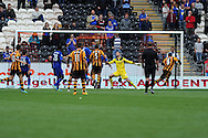 Hull's Curtis Davies (6) shoots and scores the 1st goal. . Barclays Premier league match, Hull city v Cardiff city at the KC Stadium in Hull on Sat 14th Sept 2013. pic by Andrew Orchard, Andrew Orchard sports photography,