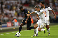 Thomas Lemar of AS Monaco is challenged  by Ben Davies of Tottenham Hotspur. UEFA Champions league match, group E, Tottenham Hotspur v AS Monaco at Wembley Stadium in London on Wednesday 14th September 2016.<br /> pic by John Patrick Fletcher, Andrew Orchard sports photography.