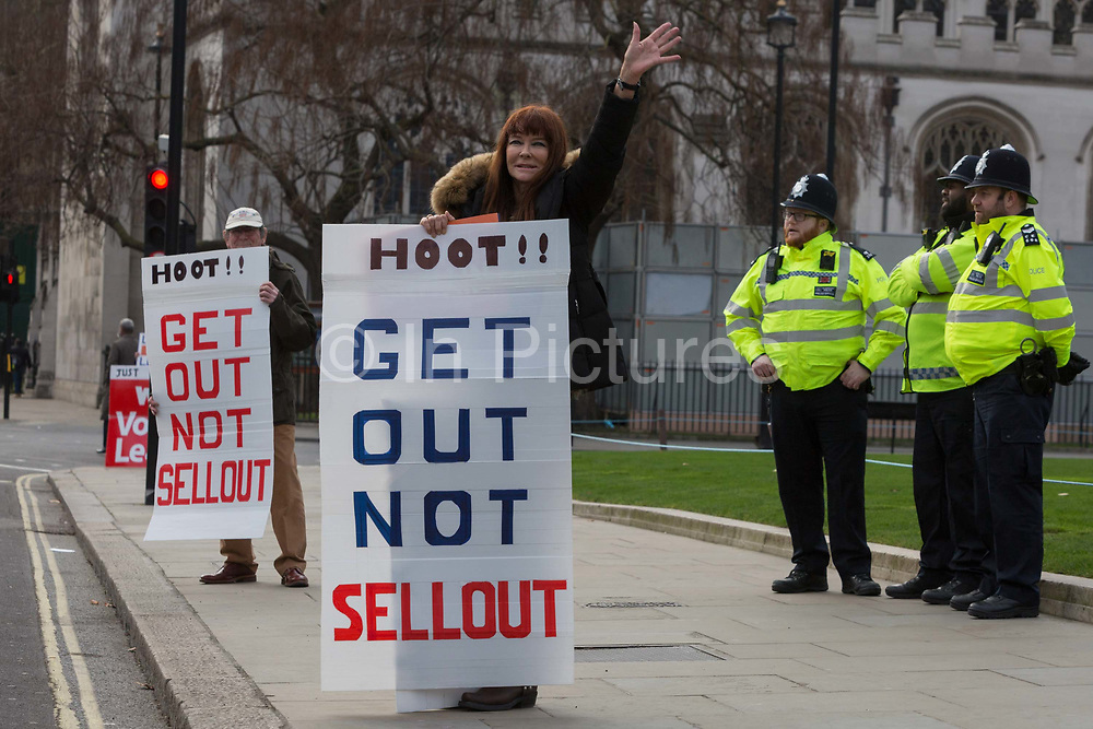 Pro-Brexiters protest and Met Police oficers outside the UK Parliament in a week that Prime Minister Theresa May once again asks for MPs to back her Brexit deal, on 14th January 2019, in Westminster, London, England.