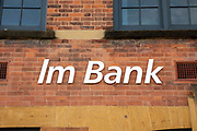 The sign for Im bank on a building in Coventry on the 28th of April 2021, Coventry, United Kingdom. Missing the E, Elm bank is a building that has been converted into luxury apartments.