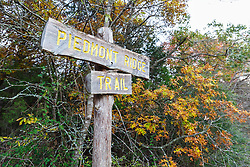 Piedmont Ridge Trail sign with fall color, Great Trinity Forest, Dallas, Texas, USA