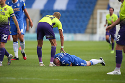 Luke Norris of Colchester United takes a blow to the face - Mandatory by-line: Arron Gent/JMP - 18/06/2020 - FOOTBALL - JobServe Community Stadium - Colchester, England - Colchester United v Exeter City - Sky Bet League Two Play-off 1st Leg