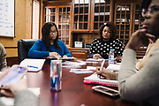 SELMA, AL – DECEMBER 19, 2019: Keshee Dozier-Smith (center), 34, leads a staff meeting at the Rural Health Medical Program office.<br /> <br /> Since joining Rural Health Medical Program as Chief Executive Officer in March 2016, Dozier-Smith has effectively moderned the 35-year-old floundering business – opening three new clinics, streamlining processes and reaching out to local companies to offer healthcare services for employees. In the wake of rising hospital closures that leave Alabama's poorest citizens disproportionately cut off from access to medical care, Dozier-Smith represents a renewed effort to bridge the rural gap by offering a quality, affordable healthcare option.