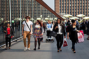 Scene outside as people flock away from the old Stratford shopping centre towards the new Westfield Shoppping Centre in Stratford, East London, UK. This is Europe's largest shopping complex. This is a relatively poor area of London, but in recent years has seen much regeneration, the construction of a major transport hub and various shopping complexes. Stratford is adjacent to the London Olympic Park and is currently experiencing regeneration and expansion linked to the 2012 Summer Olympics.