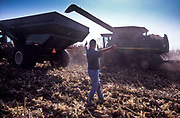 A farmer oversees the loading of Corn in America's Corn belt of Illinois state, USA. He gives the thumbs up in celebration of a year's good yield.