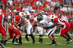 08 September 2007:  Jarek Thomas wraps up QB Jeff Ehrhardt. The Murray State Racers were defeated by the Illinois State Redbirds 43-17 in a nightcap at Hancock Stadium on the campus of Illinois State University in Normal Illinois.