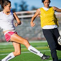 103112       Cable Hoover<br /> <br /> Ariana Aretino kicks the ball past Savannah Herrera during Miyamura girls soccer practice at Public School Stadium Wednesday.