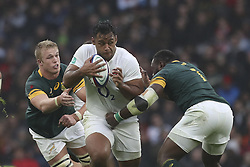 November 12, 2016 - London, England, United Kingdom - Billy Vunipola of England charges through the attempted tackles from Pieter-Steph du Toit and Tendai Mtawarira of South Africaduring Old Mutual Wealth Series between England  and South Africa played at Twickenham Stadium, London, November 12th  2016  (Credit Image: © Kieran Galvin/NurPhoto via ZUMA Press)
