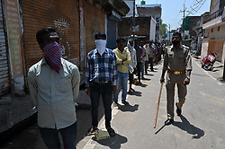 April 16, 2020, Prayagraj, Uttar Pradesh, India: Prayagraj: People maintain social distance during in a queue to take free ration at a government storeduring a nationwide lockdown imposed as a preventive measure against the spread of the COVID-19 coronavirus in Allahabad (Credit Image: © Prabhat Kumar Verma/ZUMA Wire)
