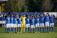 Portsmouth stand for a one minuet silence prior to kick off during the The FA Cup 1st round match between Maidenhead United and Portsmouth at York Road, Maidenhead, United Kingdom on 10 November 2018.