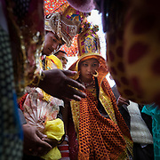 Bride is carried by mother in law inside the groom's house. Traditional wedding in the Himalaya.