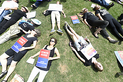 April 28, 2017 - Atlanta, Georgia, U.S.- Protesters lie on the ground at a ''die-in'' protest held at Woodruff Park organized for the day of the NRA convention that Trump would be making an appearance at the National Rifle Association's convention. The protest would carry on to a march down Marietta street to the Omni Hotel and Georgia World Congress Center where the NRA Convention was held. (Credit Image: © Henry P. Taylor/TNS via ZUMA Wire)