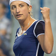 August 16, 2014, New Haven, CT:<br /> Timea Bacsinszky reacts after winning the first set during a match against Caroline Wozniacki on day four of the 2014 Connecticut Open at the Yale University Tennis Center in New Haven, Connecticut Monday, August 18, 2014.<br /> (Photo by Billie Weiss/Connecticut Open)