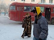 Strassenszene in der Innenstadt von Jakutsk. Jakutsk wurde 1632 gegruendet und feierte 2007 sein 375 jaehriges Bestehen. Jakutsk ist im Winter eine der kaeltesten Grossstaedte weltweit mit durchschnittlichen Winter Temperaturen von -40.9 Grad Celsius. Die Stadt ist nicht weit entfernt von Oimjakon, dem Kaeltepol der bewohnten Gebiete der Erde.<br /> <br /> Street scene in the city center of Yakutsk. Yakutsk was founded in 1632 and celebrated 2007 the 375th anniversary. Yakutsk is a city in the Russian Far East, located about 4 degrees (450 km) below the Arctic Circle. It is the capital of the Sakha (Yakutia) Republic (formerly the Yakut Autonomous Soviet Socialist Republic), Russia and a major port on the Lena River. Yakutsk is one of the coldest cities on earth, with winter temperatures averaging -40.9 degrees Celsius.