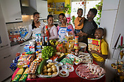 Luxembourg. Family portrait of the Lopes-Furtado family with one week's worth of food in April. The Hungry Planet project.