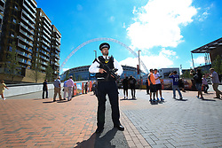 27 May 2017 - Then FA Cup Final - Arsenal v Chelsea - An armed Police officer stands guard under the arch of Wembley Stadium - Photo: Marc Atkins / Offside.