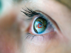 Logo from Video file sharing website YouTube is reflected from computer creen onto womans eye 2008