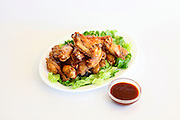 Barbecued chicken wings with sauce