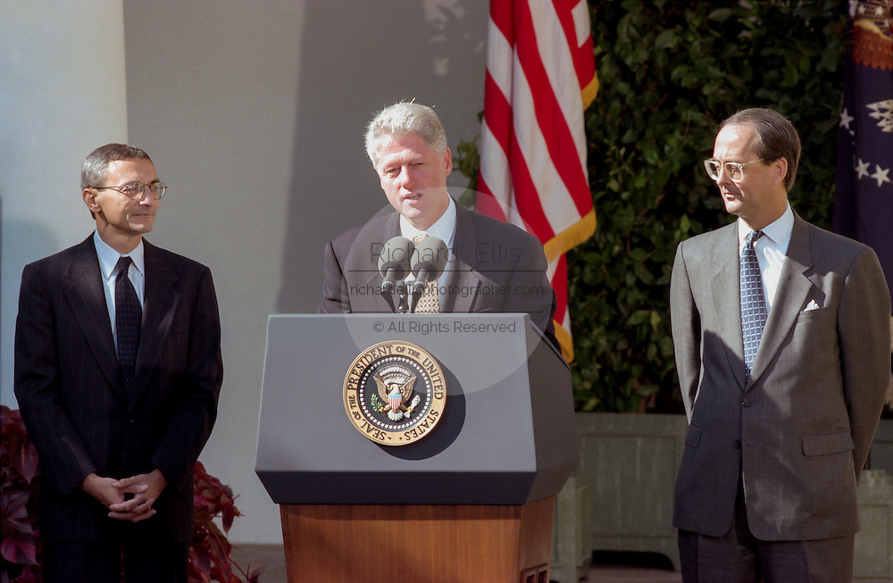 US President Bill Clinton with out-going Chief of Staff Erskine Bowles and incoming chief John Podesta (left) during a Rose Garden ceremony at the White House October 20, 1998 in Washington, DC. Clinton announced John Podesta as the new chief of staff replacing Bowles.