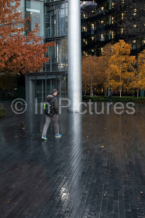 People in More London on 27th November 2019 in London, England, United Kingdom. More London, part of an area known as London Bridge City, is a development on the south bank of the Thames. It is owned by the Kuwaiti sovereign wealth fund. It includes office blocks, shops, restaurants, cafes, and a pedestrianised area.