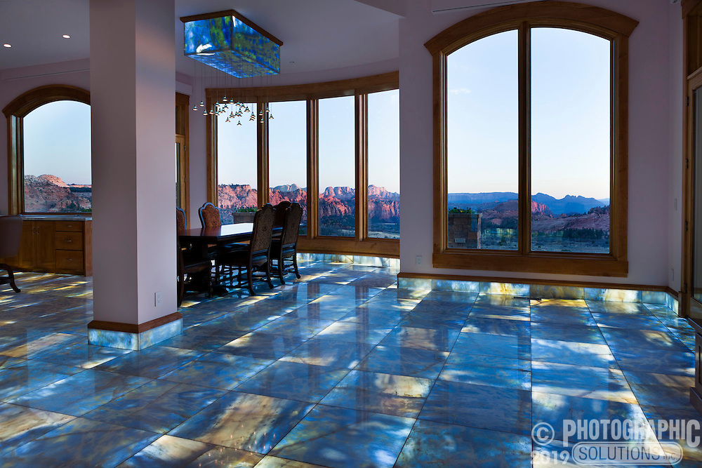 The owner of the home had a container of Italian marble, and wanted to backlight it on the floor. A lot of engineering went into the application, creating a new fiber optic system for floor lighting.