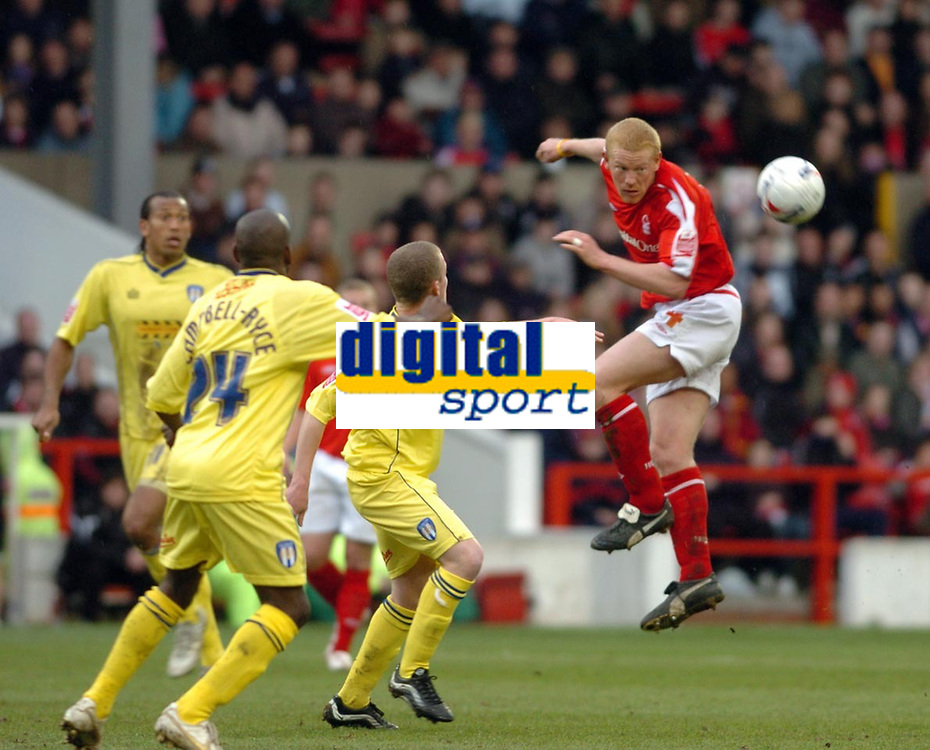 Photo: Leigh Quinnell.<br /> Nottingham Forest v Colchester United. Coca Cola League 1. 08/04/2006. Gary Holt brings the ball down for Forest watched by the colchester defence.