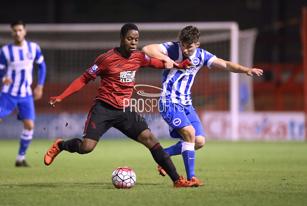 Jonathan Leko, West Bromwich Albion midfielder battles with Dylan Barnett, Brighton defender during the Barclays U21 Premier League match between Brighton U21 and U21 West Bromwich Albion at the Checkatrade.com Stadium, Crawley, England on 25 January 2016.