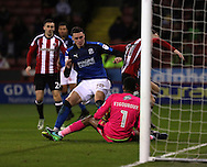 Mark Duffy of Sheffield United tussles with Lloyd Jones of Swindon Town on the goal line during the English Football League One match at Bramall Lane, Sheffield. Picture date: December 10th, 2016. Pic Jamie Tyerman/Sportimage